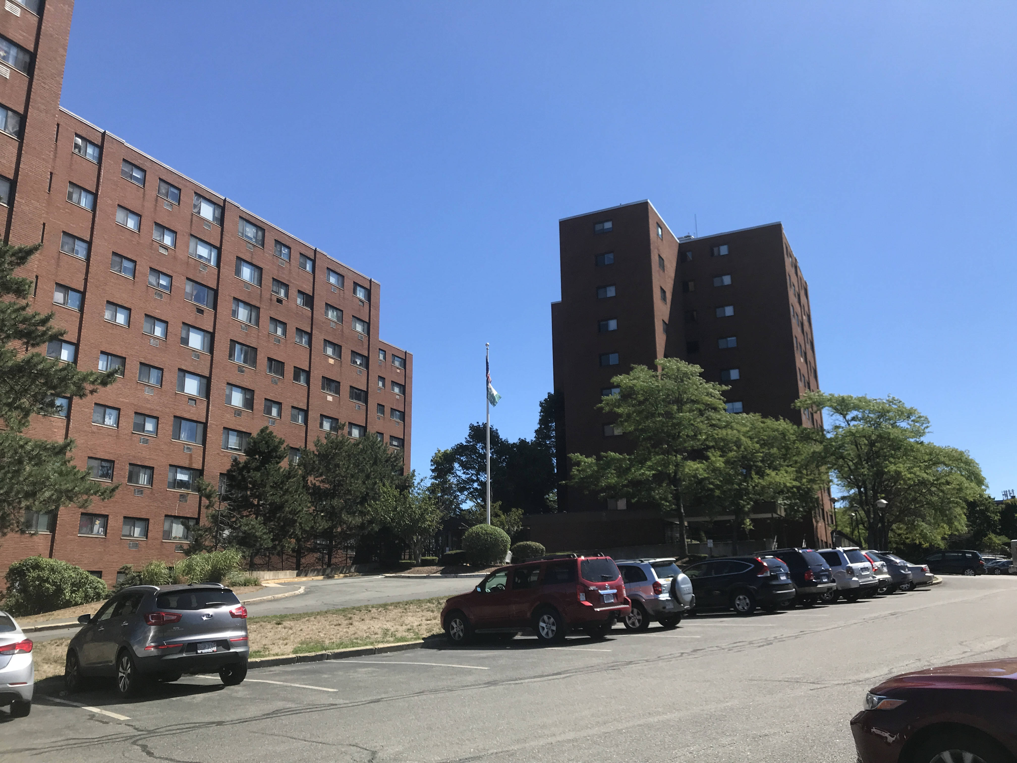 A view from the Salem Heights parking lot, showing two large rectangular brick buildings, approximately eight stories high