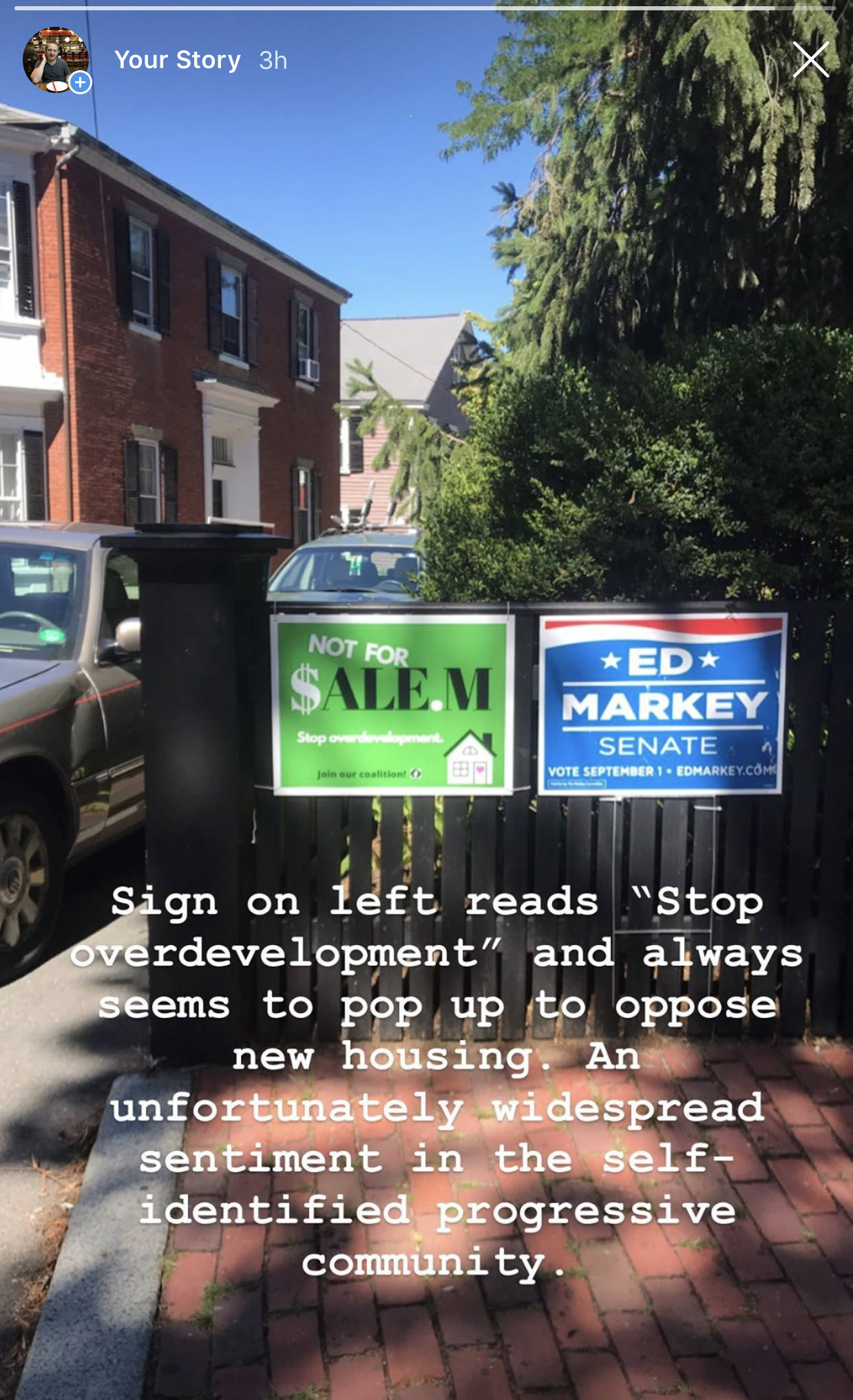 A front gate bearing two political signs; one for Ed Markey and one stating 'Not For $alem / stop overdevelopment / join our coalition' A superimposed Instagram caption reads 'Sign on the left reads 'Stop Overdevelopment' and always seems to pop up to oppose new housing. An unfortunately widespread sentiment in the self-identified progressive community'