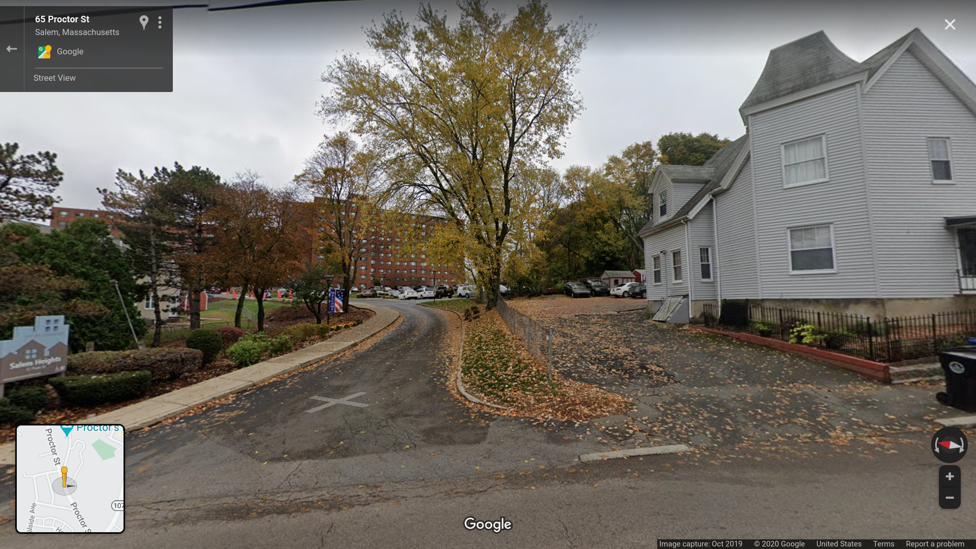 A google street view of the end of the driveway, looking up towards a brick building.